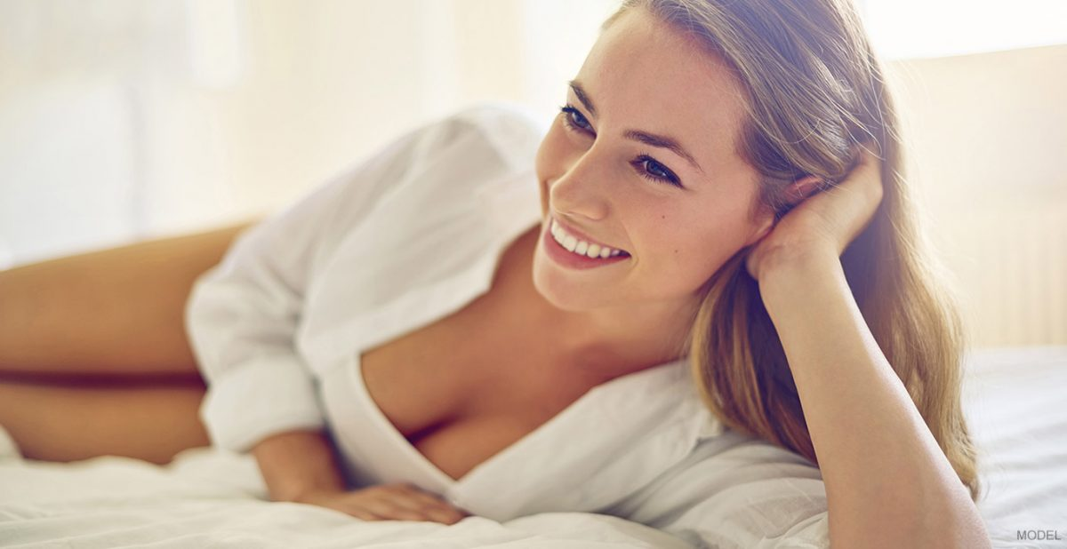 Woman laying down smiling